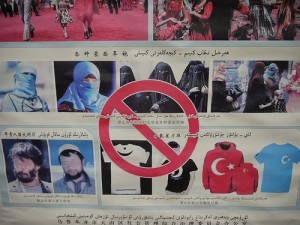 A poster in Urumqi, China indicating that Burqas, beards and other clothing pieces are banned.