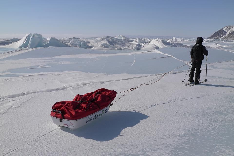 Pulling their 80kg sledges across icy terrain